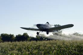 Crop Duster Spraying Roundup - Glyphosate